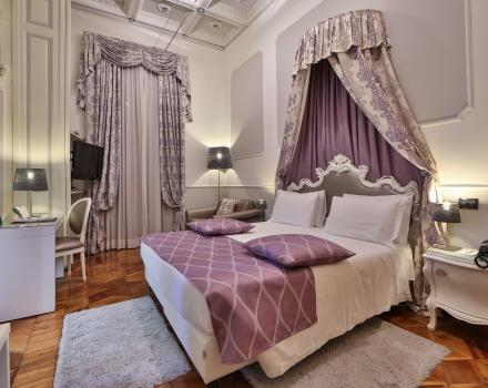 Rest, comfort and elegance in the deluxe rooms of our 4-star hotel